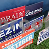 Rob Winner – rwinner@shawmedia.com<br /> <br /> Signs showing support for local republicans are seen outside the DeKalb County Republicans' tent at the Sandwich Fairgrounds on Tuesday afternoon.