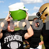 Kyle Bursaw – kbursaw@shawmedia.com<br /> <br /> Sycamore's Austin Culton grabs a drink while talking to teammate Mitchell Jordan during practice on Tuesday, Sept. 4, 2012.