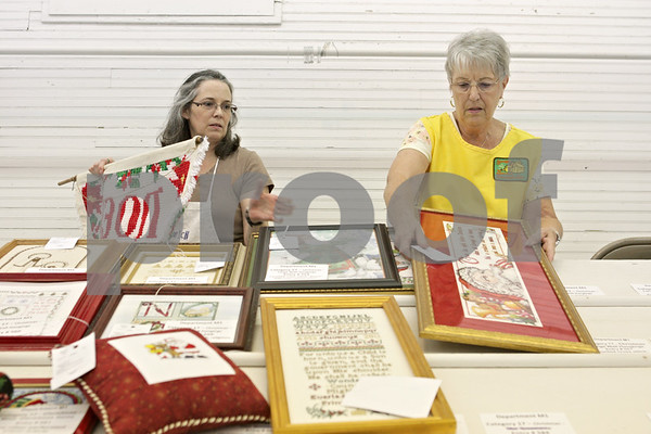 Rob Winner – rwinner@shawmedia.com<br /> <br /> On Monday afternoon, Michele Stahl (left) and Linda Holley sort Christmas items within the Home Arts Building as the Sandwich Fair prepares for its 125th year.
