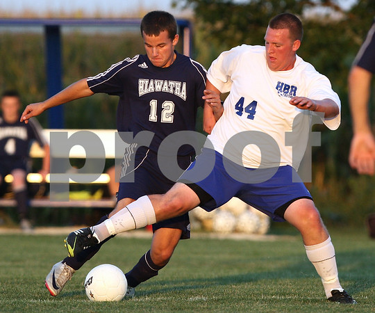 Kyle Bursaw – kbursaw@shawmedia.com<br /> <br /> Hinckley-Big Rock's Zach Michels (44) tries to get the ball away from Hiawatha's  Tyler Burger (12) during the first half of the game in Hinckley, Ill. on Wednesday, Sept. 12, 2012.