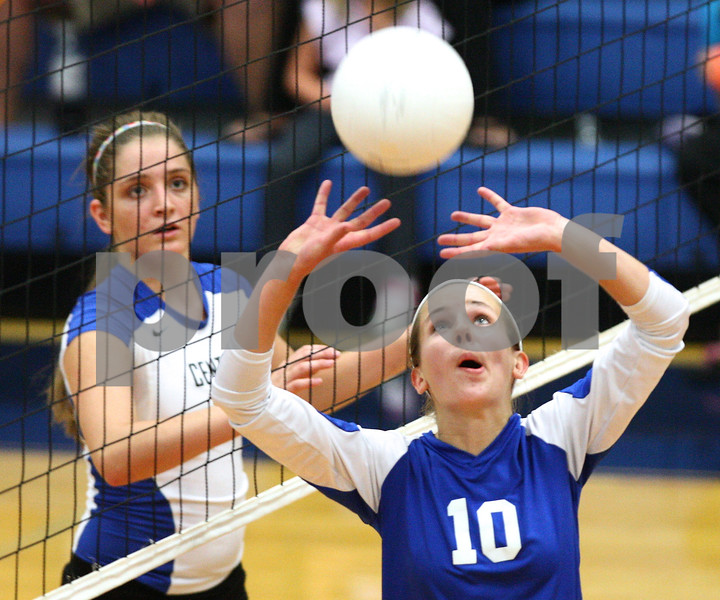 Kyle Bursaw – kbursaw@shawmedia.com<br /> <br /> Genoa-Kingston's Bridget Halat sets the ball to a teammate during the second game of the Cogs 25-11, 25-22 loss to Burlington Central on Monday, Sept. 10, 2012.