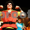 Kyle Bursaw – kbursaw@shawmedia.com<br /> <br /> Gaston, played by Garett Shuck, flexes while he and an ensemble perform Gaston's eponymous tune in Beauty and the Beast during a dress rehersal for the upcoming Penguin Project show put on through the Children's Community Theater in the DeKalb High School auditorium on Monday, Sept. 10, 2012. The Project Penguin gives children with disabilities a chance to act with the help of mentors on stage with them. The performances will be Sept. 13-15 at 7 p.m. and Sept. 16 at 2 p.m.