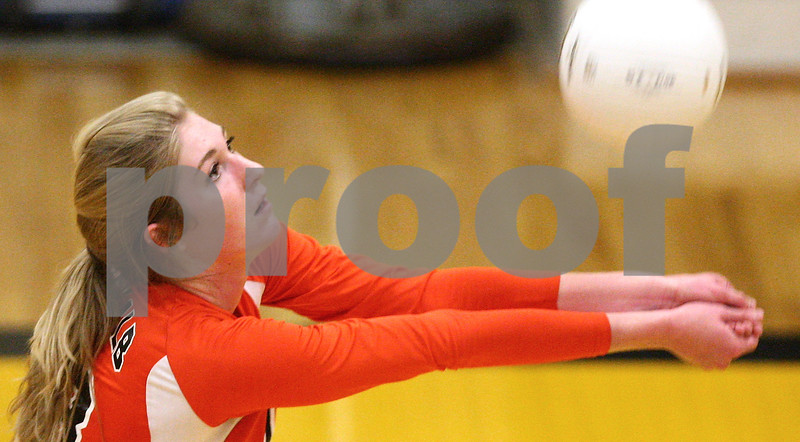 Kyle Bursaw – kbursaw@shawmedia.com<br /> <br /> DeKalb's Courtney Bemis controls the ball during the second game of DeKalb's <br /> 20-25, 29-27, 25-20 victory over the Spartans at Sycamore High School on Tuesday, Sept. 11, 2012.