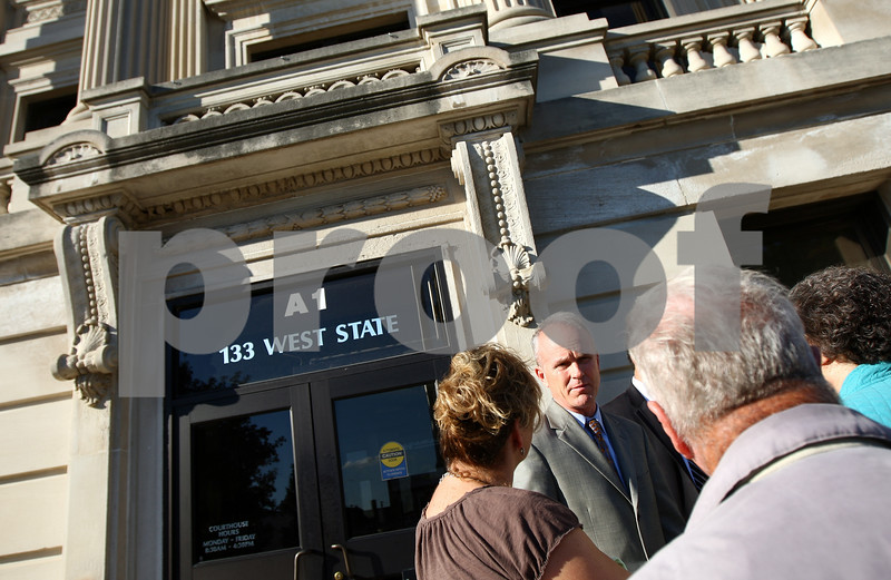 Kyle Bursaw – kbursaw@shawmedia.com<br /> <br /> DeKalb County State's Attorney Clay Campbell talks to citizens outside of the DeKalb County Courthouse following the end of the Jack McCullough trial for the day on Wednesday, Sept. 12, 2012.