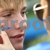 Kyle Bursaw – kbursaw@shawmedia.com<br /> <br /> Hinckley-Big Rock senior George Thompson gets some blue put on his face by classmate Erin Mahan before the start of HBR's 1000th soccer game on Wednesday, Sept. 12, 2012.