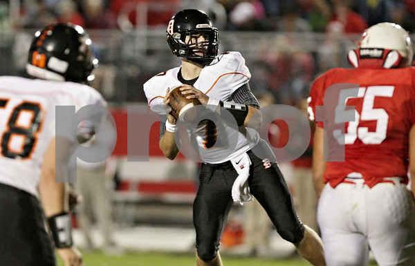 Rob Winner – rwinner@shawmedia.com<br /> <br /> DeKalb quarterback Jack Sauter locates wide receiver Jake Carpenter (not pictured) before throwing a 22-yard touchdown pass in the second quarter in Ottawa on Friday, Sept. 14, 2012.