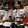 Rob Winner – rwinner@shawmedia.com<br /> <br /> DeKalb quarterback Jack Sauter (left) and wide receiver Jake Carpenter celebrate their 22-yard touchdown pass play in the second quarter in Ottawa on Friday, Sept. 14, 2012.