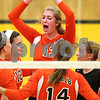 Kyle Bursaw – kbursaw@shawmedia.com<br /> <br /> DeKalb players including Jenna Scheri (12), Courtney Bemis (top) and Courtney Wagner (14) celebrate a point in the second game against Sycamore on Tuesday, Sept. 11, 2012. DeKalb beat Sycamore 20-25, 29-27, 25-20.