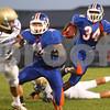 Kyle Bursaw – kbursaw@shawmedia.com<br /> <br /> Genoa-Kingston's Gabe Williams finds a hole in the first quarter against Rockford Christian in Genoa, Ill. on Friday, Sept. 14, 2012.