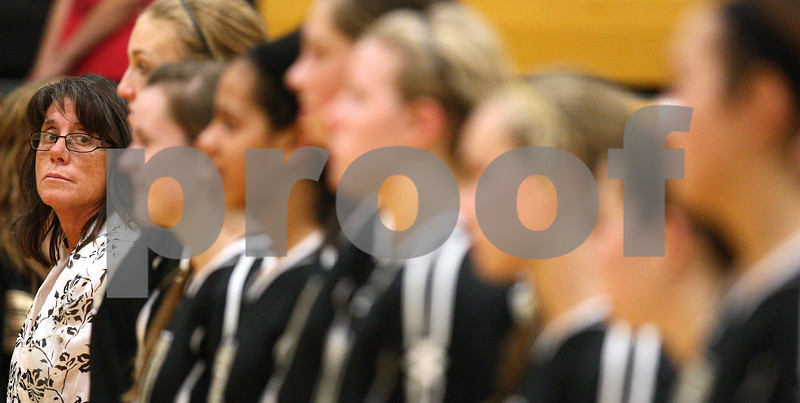 Kyle Bursaw – kbursaw@shawmedia.com<br /> <br /> Sycamore coach Debbie Klock glances at her team during the playing of the national anthem before their game against DeKalb at Sycamore High School on Tuesday, Sept. 11, 2012.