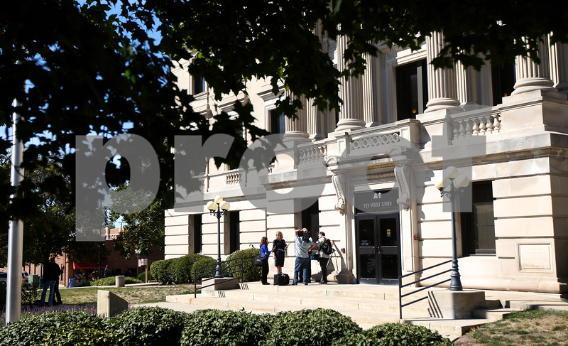 Kyle Bursaw – kbursaw@shawmedia.com<br /> <br /> Members of the media talk to one of the people lingering outside the DeKalb County Courthouse after the end of the first day of Jack McCullough's trial outside the in Sycamore, Ill. on Monday, Sept. 10, 2012.