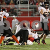 Rob Winner – rwinner@shawmedia.com<br /> <br /> DeKalb linebacker Clayton Moser (right) celebrates his sack of Ottawa quarterback William Hoffman late during the second quarter in Ottawa on Friday, Sept. 14, 2012.