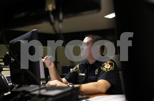 Kyle Bursaw – kbursaw@shawmedia.com<br /> <br /> Deputy Ryan Harper uses a seven monitor setup to look over the security cameras and controls the doors from the DeKalb County Jail's control room on Tuesday, Aug. 28, 2012.