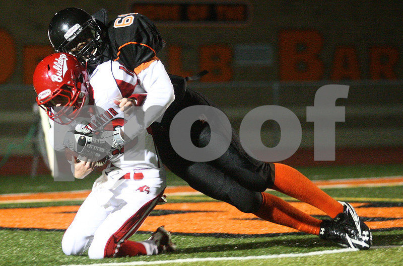 Kyle Bursaw – kbursaw@shawmedia.com<br /> <br /> DeKalb defensive lineman Jonathon Bell tackles Streator quarterback Stephen Truchon for a safety to put the Barbs up 14-0 in the first quarter of the game at DeKalb High School on Friday, Sept. 21, 2012.