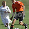 Rob Winner – rwinner@shawmedia.com<br /> <br /> DeKalb's Misha Ryzhov (front) controls a ball ahead of Sycamore's Adam Millburg during the first half in Sycamore on Tuesday afternoon. DeKalb defeated Sycamore, 4-0.