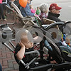 Rob Winner – rwinner@shawmedia.com<br /> <br /> Two-year-old Noah Simonson, of DeKalb, covers his ears as a fire truck sounds its siren to kick off the DeKalb High School homecoming parade in downtown DeKalb on Thursday evening.