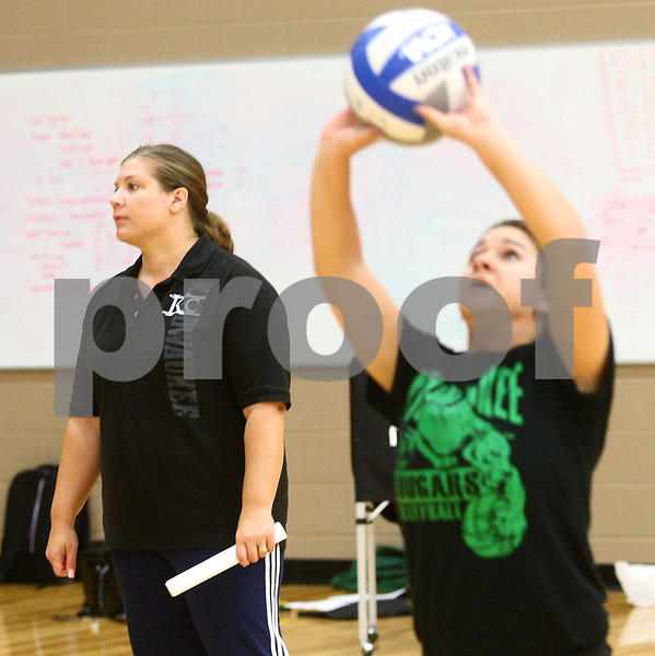 Kyle Bursaw – kbursaw@shawmedia.com<br /> <br /> Kishwaukee College volleyball coach Stephanie Gooden watches her players do a drill during practice at DeKalb High School on Monday, Sept. 17, 2012.