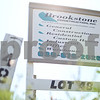 Kyle Bursaw – kbursaw@shawmedia.com<br /> <br /> A sign advertising a construction company sits in a grassy area in a Sycamore development on Wednesday, Sept. 19, 2012.