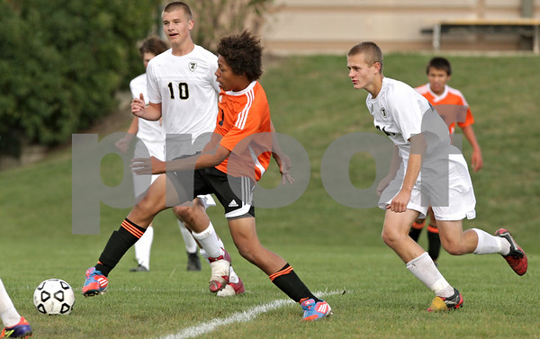 Rob Winner – rwinner@shawmedia.com<br /> <br /> DeKalb's Zack Dixson-Smith (1) scores the Barbs' second goal during the first half at Sycamore Tuesday afternoon. DeKalb defeated Sycamore, 4-0.