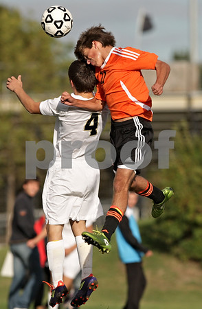 Rob Winner – rwinner@shawmedia.com<br /> <br /> Sycamore's Kevin Maillefer (4) and DeKalb's Trevor Freeland (11) go up for a ball near the Spartans' goal during the first half in Sycamore Tuesday afternoon. DeKalb defeated Sycamore, 4-0.