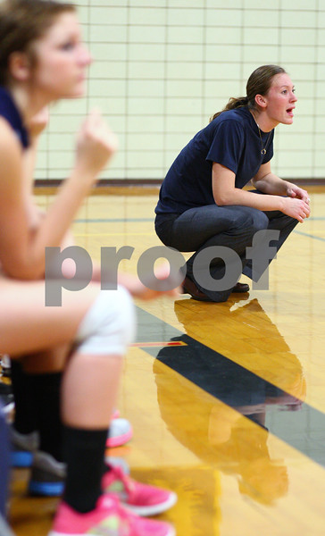 Kyle Bursaw – kbursaw@shawmedia.com<br /> <br /> Hiawatha coach Jenna Araujo calls out to her players from the sideline during the second game of Hiawatha's victory over Christian Liberty Academy in Kirkland, Ill. on Monday, Sept. 17, 2012