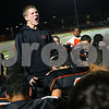 Kyle Bursaw – kbursaw@shawmedia.com<br /> <br /> Ryan Metzker, who was not dressed due to a knee injury, gets his teammates pumped up before the game against Streator at DeKalb High School on Friday, Sept. 21, 2012.