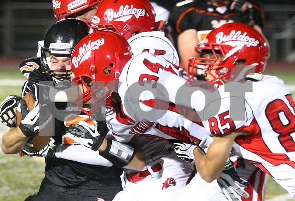 Kyle Bursaw – kbursaw@shawmedia.com<br /> <br /> DeKalb's Dylan Hottsmith pushes forward against Streator defenders in the second quarter of the game at DeKalb High School on Friday, Sept. 21, 2012.