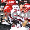 Kyle Bursaw – kbursaw@shawmedia.com<br /> <br /> DeKalb's Dylan Hottsmith pushes forward against Streator defenders in the second quarter of the game at DeKalb High School on Friday, Sept. 21, 2012.