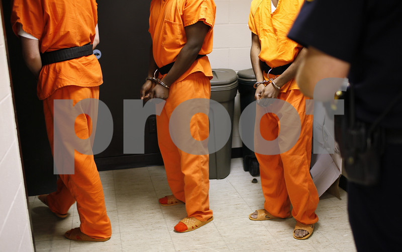Kyle Bursaw – kbursaw@shawmedia.com<br /> <br /> Deputy Michael Emmer escorts three inmates around the DeKalb County Jail on Tuesday, Aug. 28, 2012.
