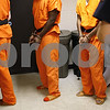 Kyle Bursaw – kbursaw@shawmedia.com<br /> <br /> Deputy Michael Emmer escorts three inmates around the DeKalb County Jail on Tuesday, Aug. 28, 2012.