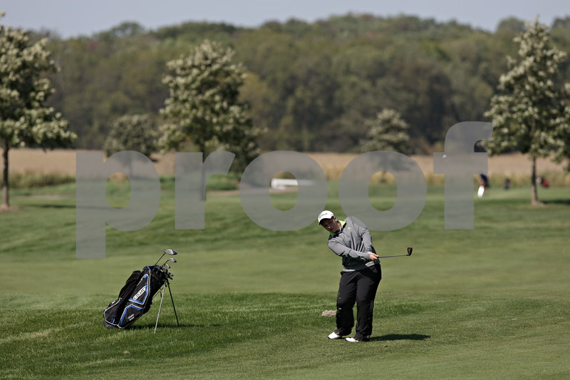 Rob Winner – rwinner@shawmedia.com<br /> <br /> Austin Scott, of Hinckley-Big Rock, takes his second shot on the sixth hole at Whitetail Ridge in Yorkville during a Little Ten Conference meet Wednesday afternoon.