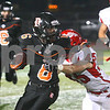 Kyle Bursaw – kbursaw@shawmedia.com<br /> <br /> DeKalb's Demetrios Collins shakes off Streator's Kyle Kurdziolek in the second quarter of the game at DeKalb High School on Friday, Sept. 21, 2012.