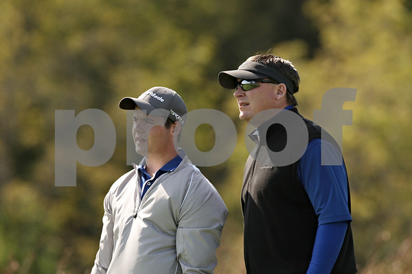 Rob Winner – rwinner@shawmedia.com<br /> <br /> Luke Winkle (left), of Hinckley-Big Rock, talks with his coach, Rodney Jandt, before teeing off on the seventh hole at Whitetail Ridge in Yorkville during a Little Ten Conference meet Wednesday afternoon.
