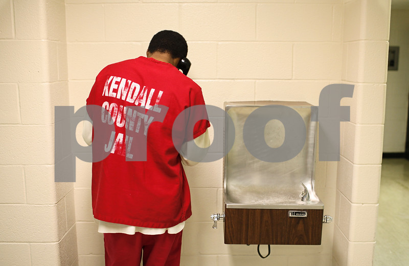 Kyle Bursaw – kbursaw@shawmedia.com<br /> <br /> Besides the inmates residing in the DeKalb County Jail, inmates from other counties have to come there for court appearances and other reasons. Here a Kendall County Jail inmate makes a phone call while being kept at the DeKalb County Jail.