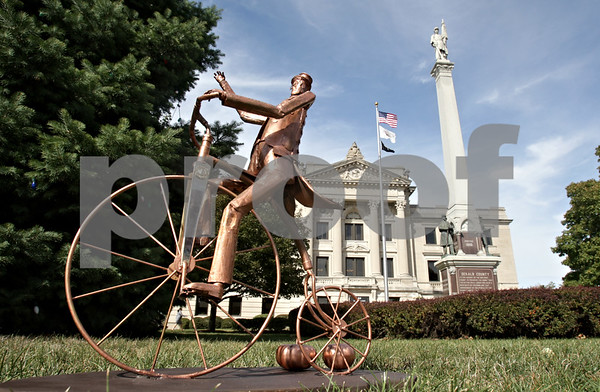 Rob Winner – rwinner@shawmedia.com<br /> <br /> A scale model of a proposed life-size Wally Thurow, or Mr. Pumpkin, statue is seen in front of the DeKalb County Courthouse in Sycamore Thursday, Sept. 20, 2012.