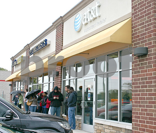 About 20 people line up outside the AT&T store in DeKalb to pick up the new iPhone 5 released Friday.<br /> <br /> By Nicole Weskerna - nweskerna@shawmedia.com