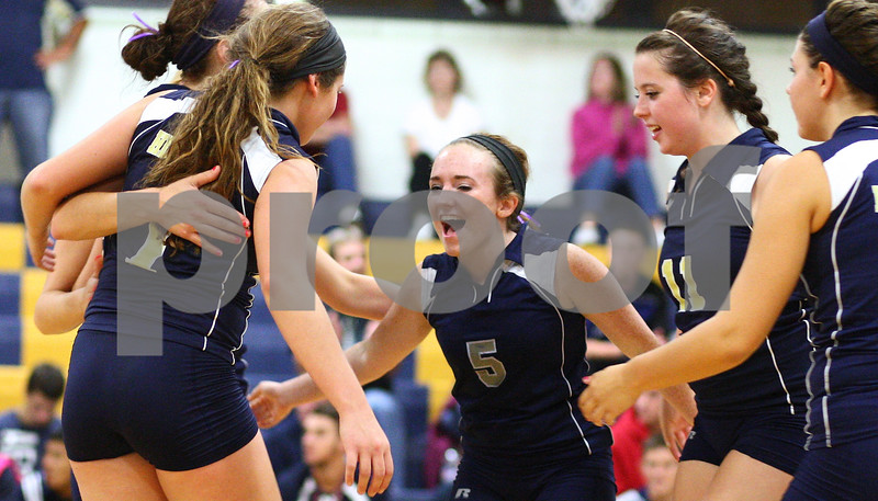 Kyle Bursaw – kbursaw@shawmedia.com<br /> <br /> Hiawatha players including Lauren Leffelman (5) celebrate a point in the first game of Hiawatha's victory over Christian Liberty Academy in Kirkland, Ill. on Monday, Sept. 17, 2012