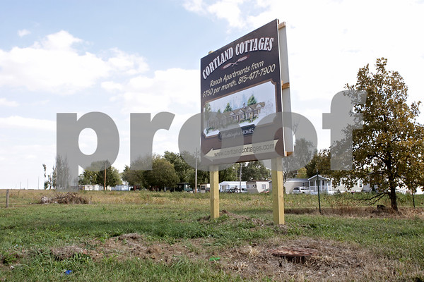 Rob Winner – rwinner@shawmedia.com<br /> <br /> A sign for Cortland Cottages, a new apartment building development for older adults, is seen near the corner of Robinson Avenue and Somonauk Road in Cortland on Tuesday afternoon.