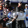 Rob Winner – rwinner@shawmedia.com<br /> <br /> Northern Illinois running back Leighton Settle (23) is forced out-of-bounds by Kansas cornerback Greg Brown (5) after a 9-yard run during the second quarter at Huskie Stadium in DeKalb, Ill., on Saturday, Sept. 22, 2012. Northern Illinois defeated Kansas, 30-23.