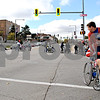 As he pushes Nathan Palkovic of Peoria in a wheelchair Saturday, Robert Parker of Peoria looks back at the line of Wheel-A-Thon participants as they cross First Street in DeKalb. The event is a fundraiser for DeKalb County RAMP Center for Independent Living.<br /> <br /> By Nicole Weskerna - nweskerna@shawmedia.com