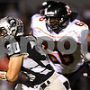 Kyle Bursaw – kbursaw@shawmedia.com<br /> <br /> Kaneland running back Jesse Balluff gets by DeKalb's Jonathon Bell in the first quarter of the game at Kaneland High School on Friday, Sept. 28, 2012.