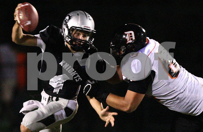 Kyle Bursaw – kbursaw@shawmedia.com<br /> <br /> DeKalb defensive lineman Jake Smith sacks Kaneland quarterback Drew David in the first quarter of the game at Kaneland High School on Friday, Sept. 28, 2012.