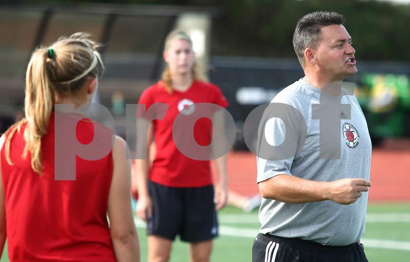 Kyle Bursaw – kbursaw@shawmedia.com<br /> <br /> John Ross, Northern Illinois University's women's soccer coach, instructs his players at practice on Tuesday, Sept. 25, 2012.