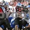 Rob Winner – rwinner@shawmedia.com<br /> <br /> On a third down, Northern Illinois quarterback Jordan Lynch carries the ball for a 14-yard gain during the fourth quarter at Huskie Stadium in DeKalb, Ill., on Saturday, Sept. 22, 2012. Northern Illinois defeated Kansas, 30-23.