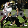 Rob Winner – rwinner@shawmedia.com<br /> <br /> Morris running back Reese Sobol (30) is forced out of bounds by Sycamore's Ben Niemann (8) and Brett Weaver (4) during the second quarter in Sycamore Friday, Sept. 28, 2012.
