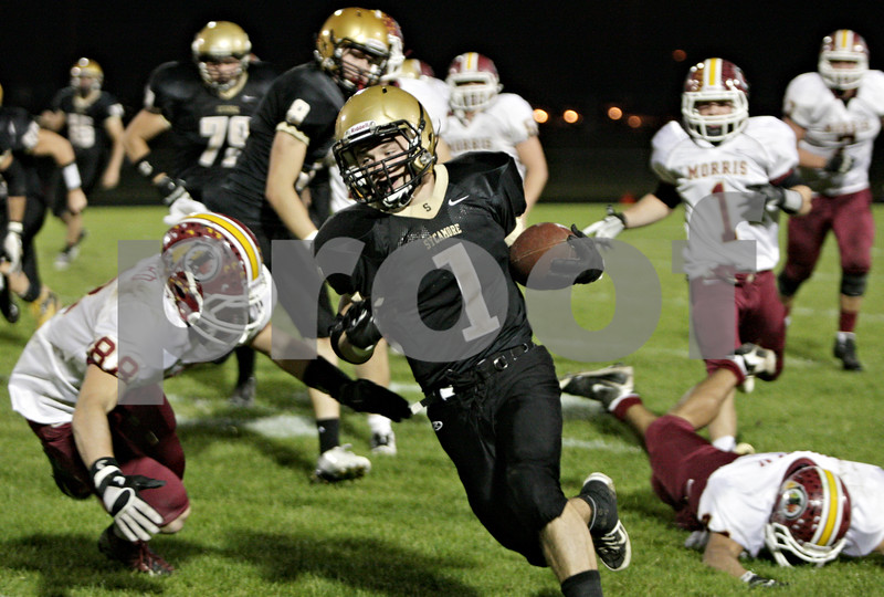 Rob Winner – rwinner@shawmedia.com<br /> <br /> Sycamore running back Austin Culton carries the ball for a gain during the second quarter in Sycamore Friday, Sept. 28, 2012.