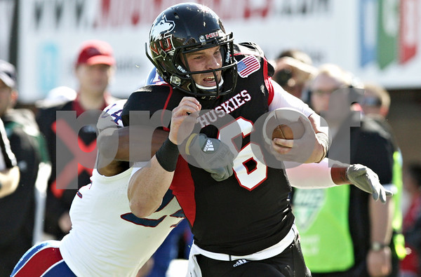 Rob Winner – rwinner@shawmedia.com<br /> <br /> Northern Illinois quarterback Jordan Lynch (6) is tackled by Kansas safety Bradley McDougald after a 17-yard run during the first quarter at Huskie Stadium in DeKalb, Ill., on Saturday, Sept. 22, 2012. Northern Illinois defeated Kansas, 30-23.