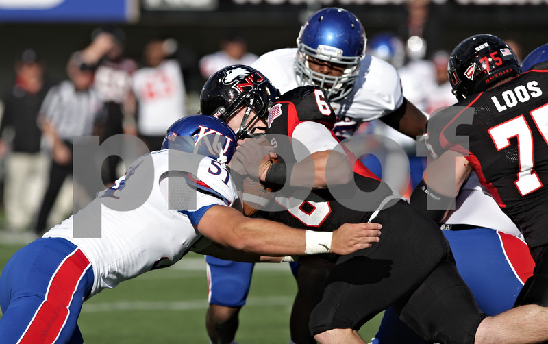 Rob Winner – rwinner@shawmedia.com<br /> <br /> Kansas linebacker Anthony McDondald (51) hits Northern Illinois quarterback Jordan Lynch after a 1-yard gain just before the end of the third quarter at Huskie Stadium in DeKalb, Ill., on Saturday, Sept. 22, 2012. Northern Illinois defeated Kansas, 30-23.