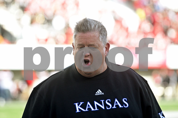Rob Winner – rwinner@shawmedia.com<br /> <br /> Kansas coach Charlie Weis discusses a holding call with an official that occurred on a PAT during the fourth quarter at Huskie Stadium in DeKalb, Ill., on Saturday, Sept. 22, 2012. Northern Illinois defeated Kansas, 30-23.