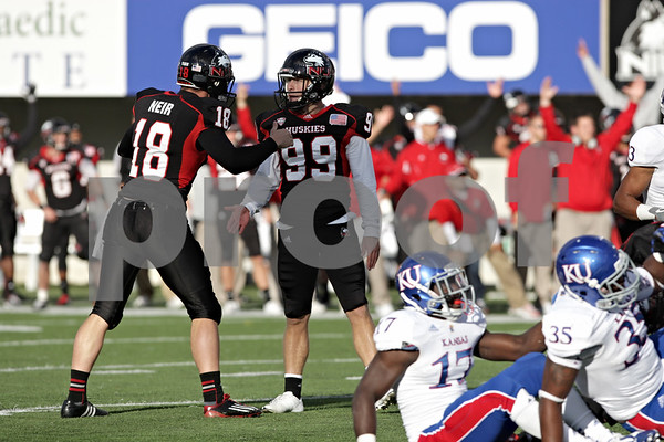 Rob Winner – rwinner@shawmedia.com<br /> <br /> Northern Illinois' Ryan Neir (18)congratulates kicker Mathew Sims (99) after Sims tied the game at 23 with a 44-yard field goal during the fourth quarter at Huskie Stadium in DeKalb, Ill., on Saturday, Sept. 22, 2012. Northern Illinois defeated Kansas, 30-23.